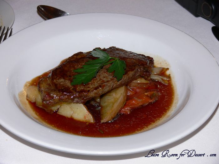 Sirloin of Beef on Roasted Potatoes, Tomato, Onion, Rosemary and Garlic Compote