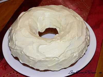 Orange frosting on the cooled cake - ready to eat!