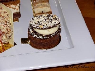 """W"" - Chocolate pop rock & popcorn disc, vanilla almond chantilly, dulce de leche, flourless chocolate sponge, almond feulletine."