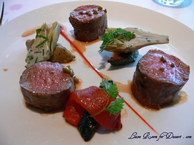 Lamb - basil scented fillet with red capsicum, baby artichokes and green olive and lavender sauce