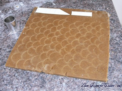 For the tiles on the roof - Use a small circle cutter to make semi circle indents in the dough before backing